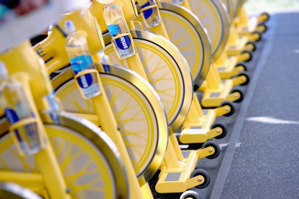 Clip in for this studio cycling comparison: FlyWheel vs. SoulCycle