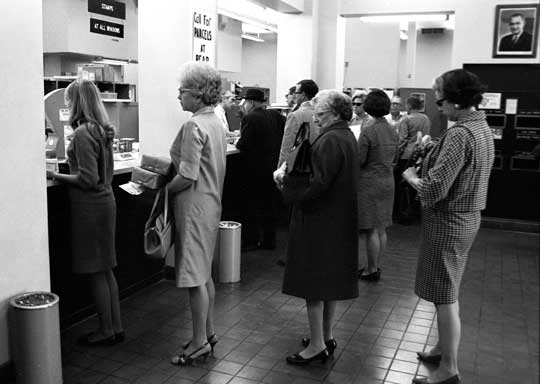 Waiting in line at the post office on tax day
