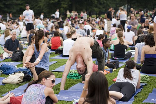 Stretching, pigeon pose, bridge pose Yoga at the Great Lawn