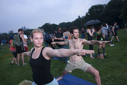 Warrior II yoga pose in Central Park WellandGoodNYC.com