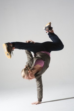 Anya Porter yogi breakdancer in one-handed handstand