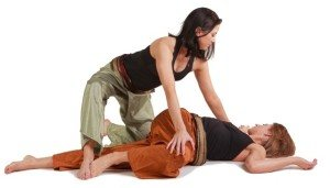 Assisted Thai massage twist