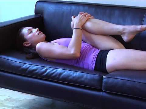 Tara Stiles doing Couch Yoga