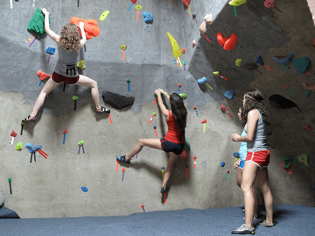 women climbing at Brooklyn Boulders