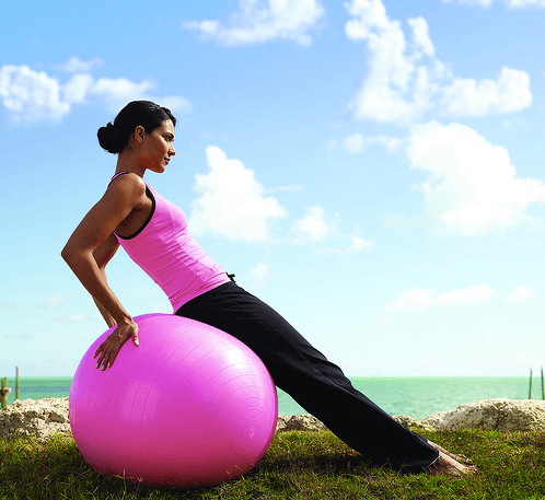 woman on Pilates ball
