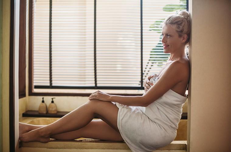 woman relaxing in bathroom