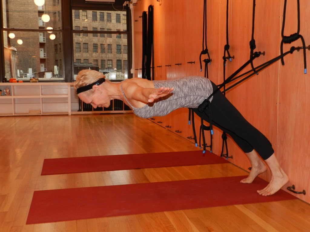 3 things a yoga rope wall can do for your practice | Well+Good