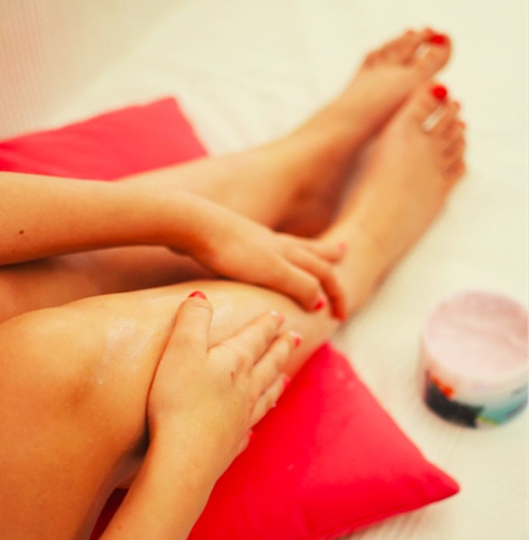 woman putting on lotion after bikini wax