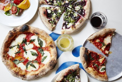 Pizza piled high with veggies—and a side of beach vibes