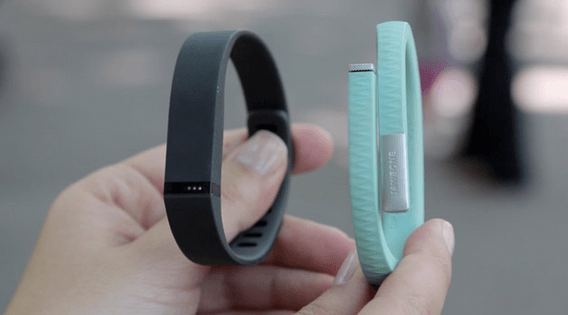 The makers of Jawbone, right, are accusing rival brand Fitbit, left, of stealing their data.