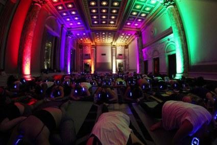 The crazy popular headphone-wearing yoga phenomenon has hit Manhattan