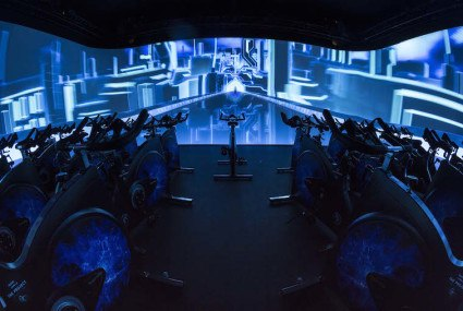 Will cycling in front of a big screen catch on as a fitness trend?