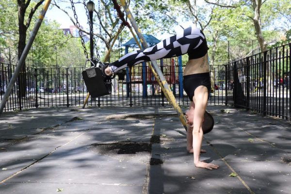 Channel your inner child with this ab-busting swing set workout
