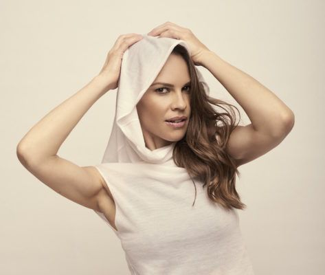 "Hilary Swank's Latest Role? Redefining Activewear With a Hot ""Crossover"" Collection"