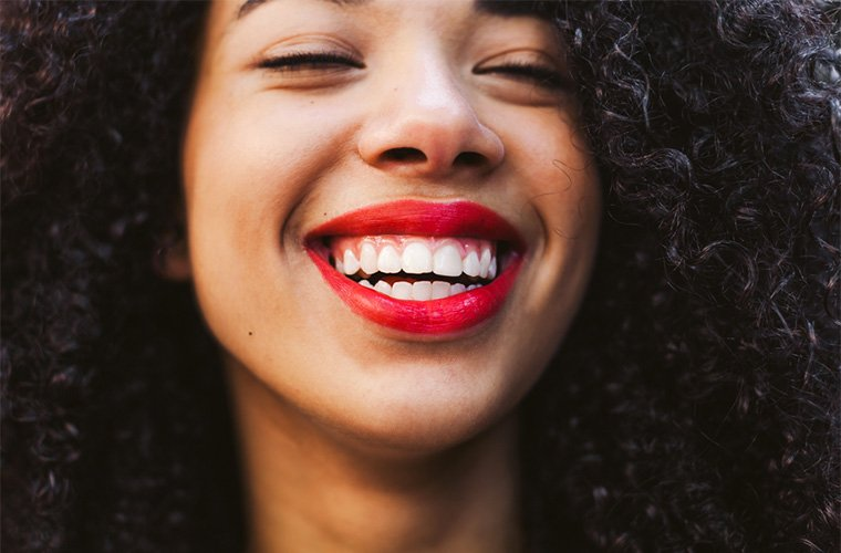 7 festive red lipsticks that are all-natural—and will actually stay put