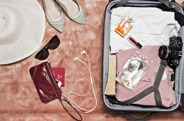 stocksy-alita-ong-travel-light-suitcase