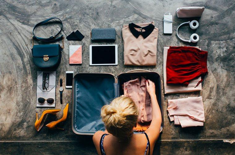 stocksy-lumina-woman-packs-her-suitcase