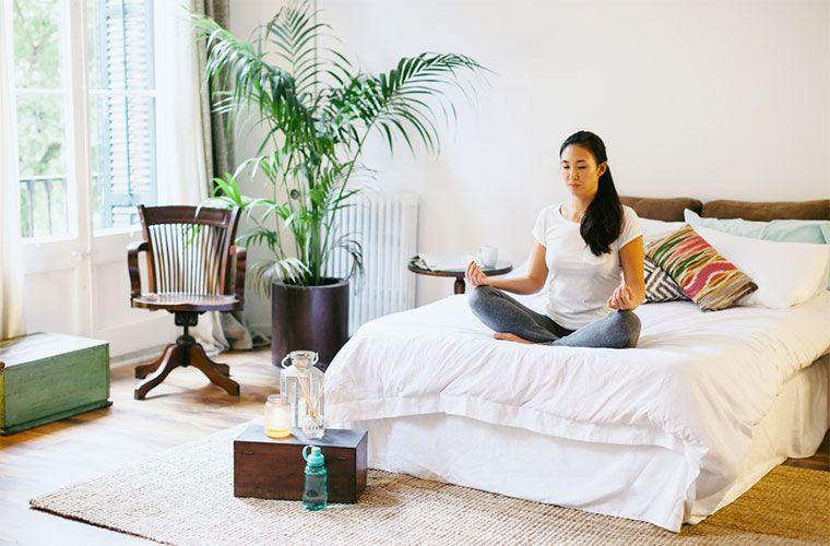 stocksy-bonninstudio-young-asian-woman-meditating-in-the-lotus-pose