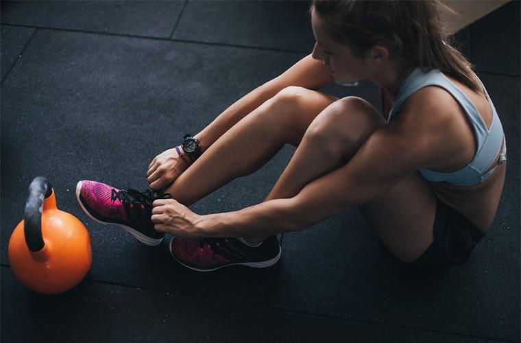 stocksy_studio-firma-weight-training-in-gym