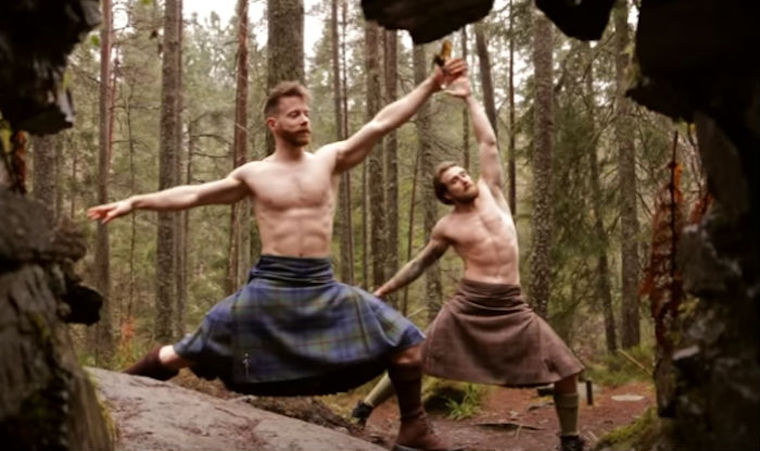 Men in kilts doing yoga