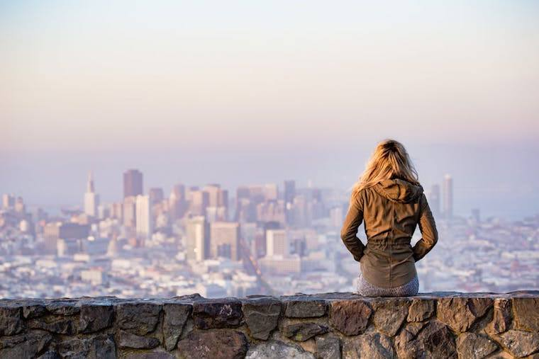 woman overlooking city