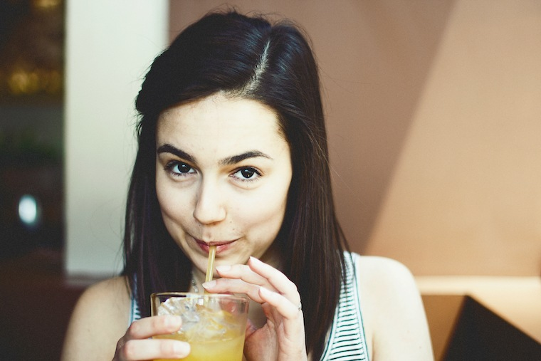 woman smiling juice