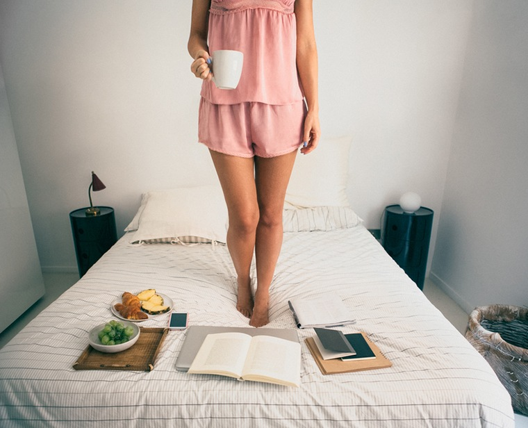 woman standing in bed