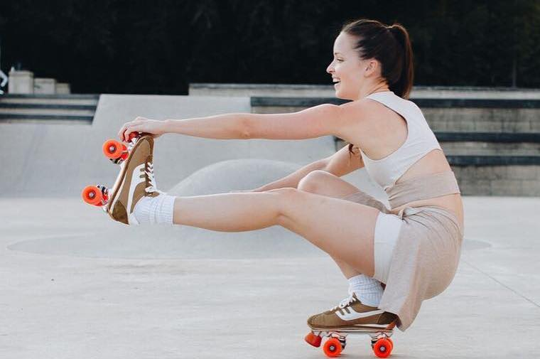 Woman roller skating in workout Court Skort by Outdoor Voices