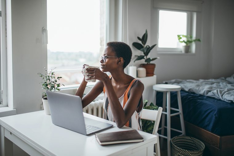 woman at laptop with coffee