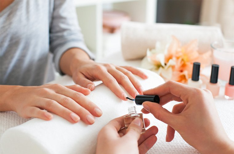 woman getting nails polished