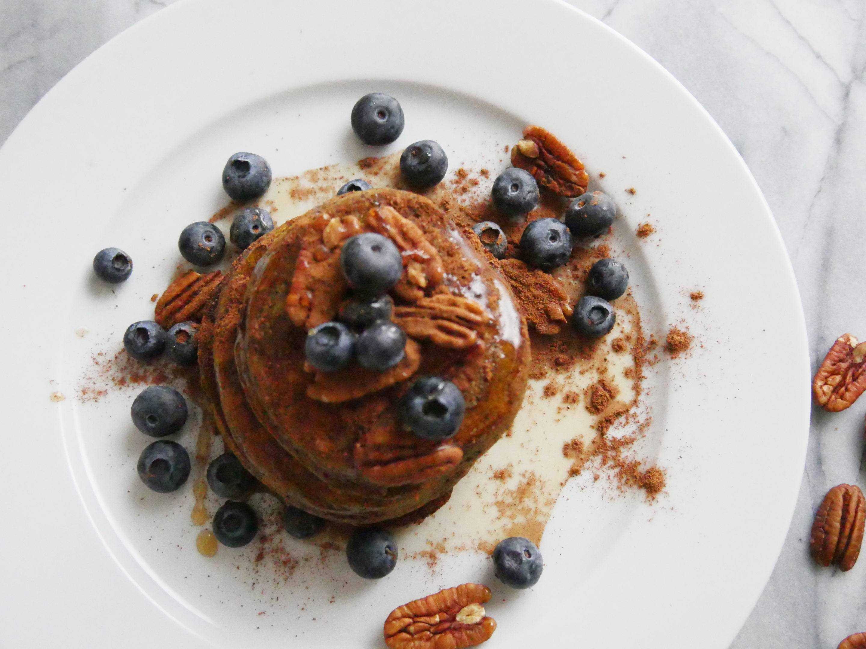 THIS PUMPKIN SPICE PROTEIN PANCAKE RECIPE FROM HEALTHY CHEF LILY KUNIN IS A SATURDAY MORNING GAME-CHANGER