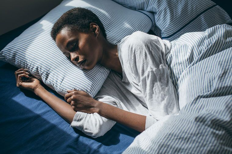 What your go-to sleeping position says about you, according to the pros
