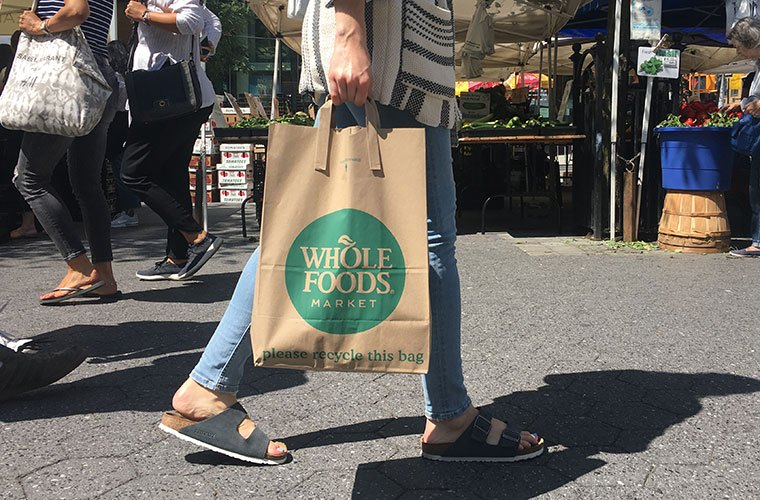 Whole Foods bag at farmers' market