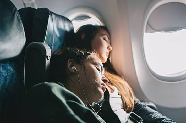 HOW TO SLEEP WELL ON A PLANE—EVEN IN COACH