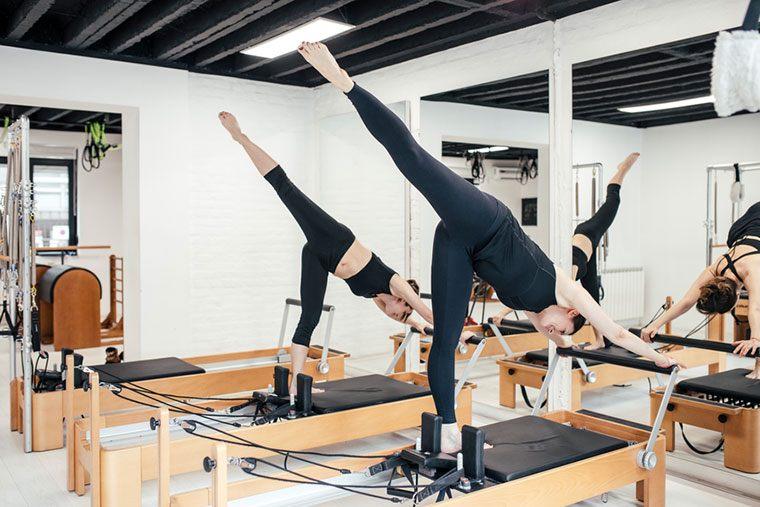 Women in Pilates reformer class