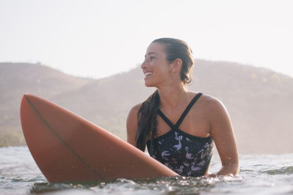 Plan to surf on your beachy getaway? Keep your mouth closed—for your health