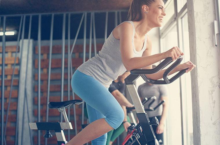 Woman riding spin bike