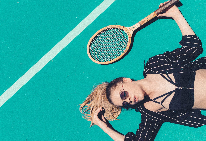 Girl lying on tennis court