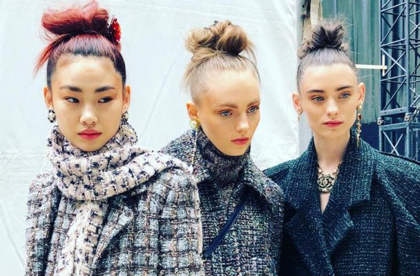 Your go-to post-gym messy bun is getting high-fashion attention at Paris Fashion Week