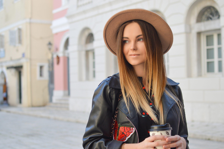 Girl wearing hat holding coffee