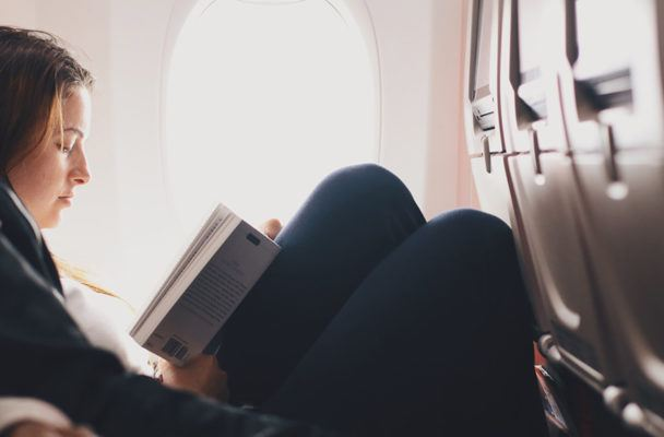 Here's how to *not* catch your airplane seatmate's cold on the way to your spring vacay