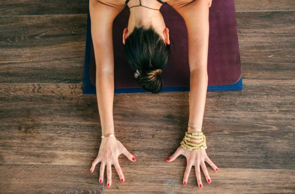 Inside the intense legal battle that's dividing the yoga world