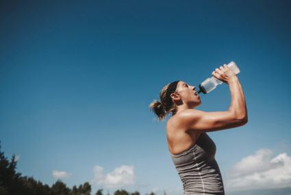 This is how much water to drink after a sweat sesh—according to doctors