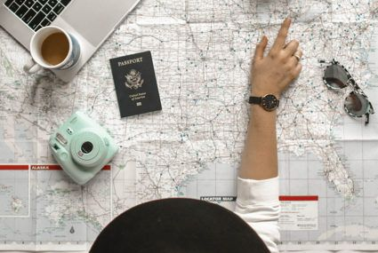 Woman planning trip with map