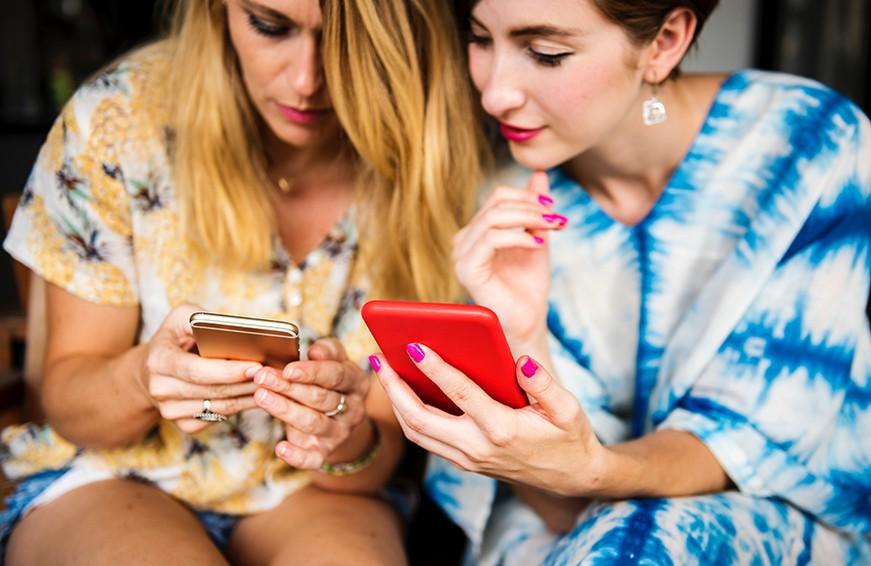 Women looking at smartphones