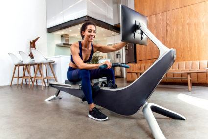 The rowing-machine version of Peloton wants you to feel like you're on an IRL river