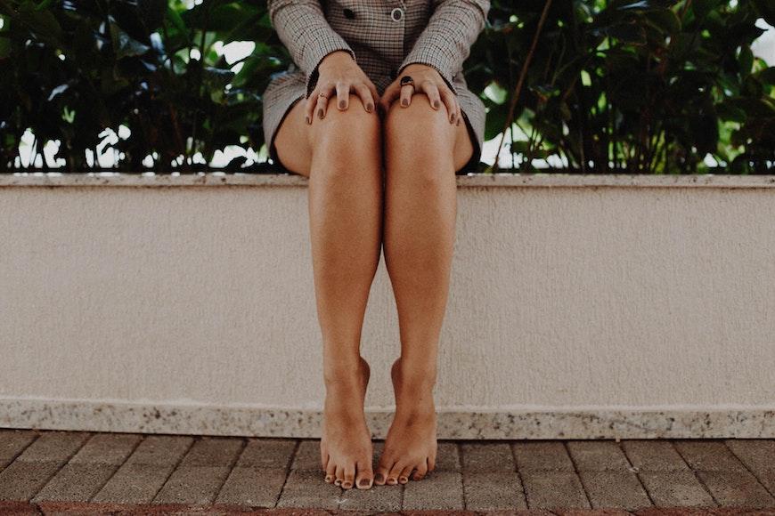 woman's legs, sitting