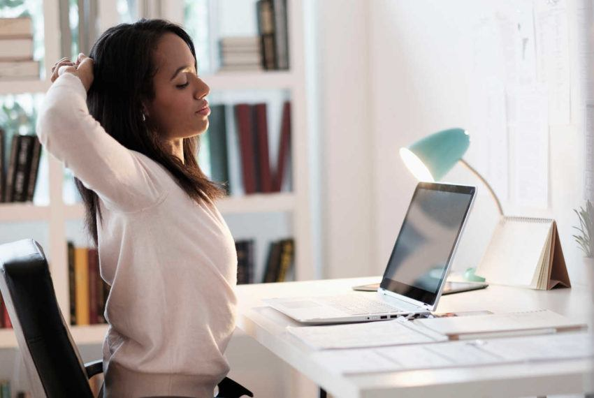 4 chair yoga moves that treat back pain sustained from slouching at your desk job