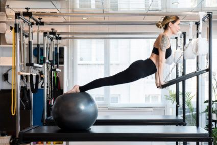 Get in an intense workout *anywhere* using this completely collapsable Pilates reformer