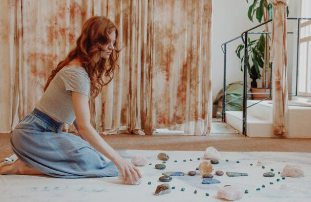 Like sage and palo santo, crystal grids can up the good vibes in your home—but what are they?